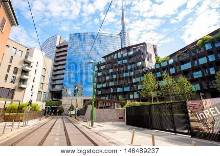 Milan, Italy - June 07, 2016: Modern residantial buildings and Unicredit tower in Porta Nuova business district in Milan in the morning
