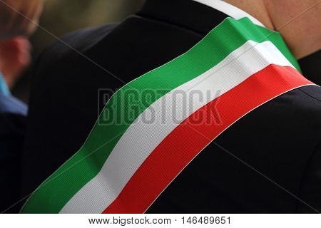 the typical Italian tricolor flag of the Mayor