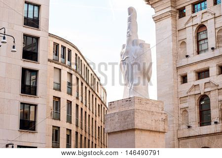 Milan, Italy - June 07, 2016: L.O.V.E. statue which stands for Freedom, Hate, Vengeance and Eternity was created in 2010 by the Italian artist Maurizio Cattelan on Affari square in Milan
