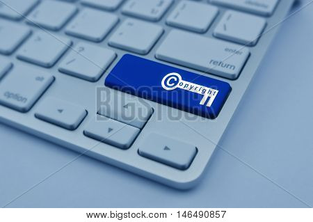 Copyright key icon on modern computer keyboard button Copyright and patents concept blue tone