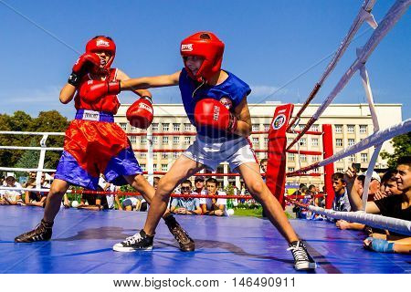 Uzhhorod Ukraine - September 9. 2016: The students of the local school of boxing demonstrate their skills in the ring during the celebration of the Physical Culture and Sports Day. Similar events are held on this day in all cities of Ukraine.
