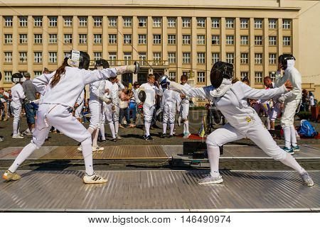 Uzhhorod Ukraine - September 9. 2016: Young athletes demonstrate their mastery of fencing during the celebration of Physical Culture and Sports Day. Similar events are held on this day in all cities of Ukraine.
