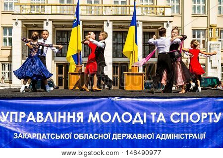 Uzhhorod Ukraine - September 9. 2016: Young participants of the local sports dance sections performed a waltz on stage during the celebration of the Physical Culture and Sports Day. Similar events are held on this day in all cities of Ukraine.