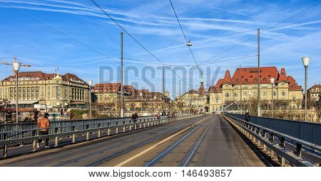 Bern, Switzerland - 29 December, 2015: view along the Kirchenfeldbrucke bridge towards Casinoplatz square. The Kirchenfeldbrucke is a bridge over the Aare river, connecting Casinoplatz square in the city's old town with Helvetiaplatz square.
