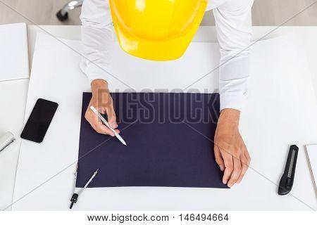 Engineer In Helmet Drawing Blueprint