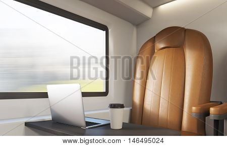 Brown Armchair And Laptop In Train Compartment