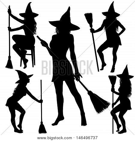 Black silhouettes of young Halloween witch standing with broomstick.