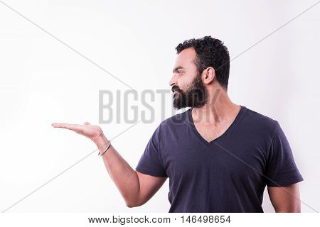 Indian young Man with beard presenting something, isolated over white background