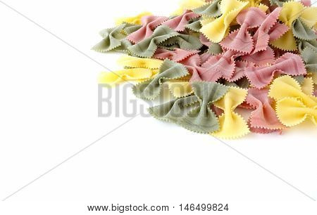 Heap of extra large multicolored farfalle pasta isolated on a white background.