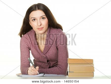 Girl Sitting At The Table