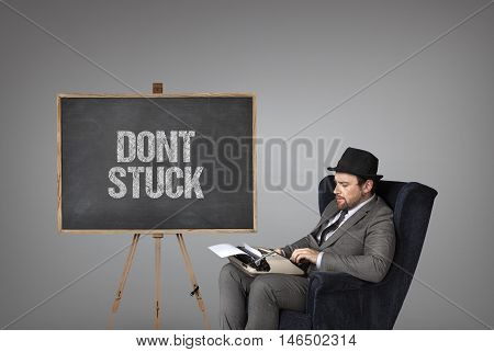 Dont stuck text on  blackboard with businessman and key