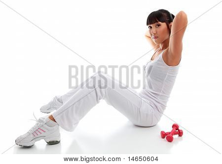Beautiful Young Woman Exercising Sit Ups