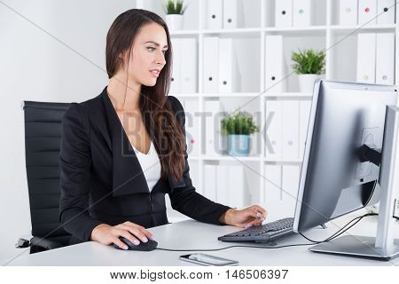 Manager With Long Hair Working At Desktop