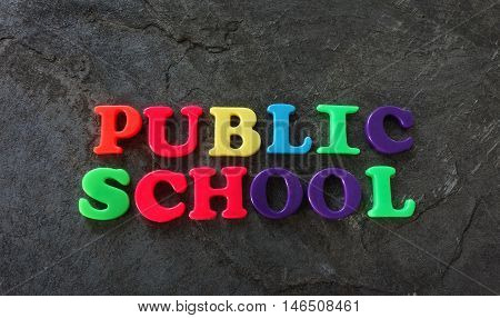 Public School spelled out with colorful play letters