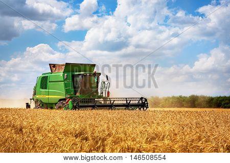Dobrich Bulgaria - July 08: Modern John Deere combine harvesting grain in the field near the town Dobrich Bulagaria July 08 2016