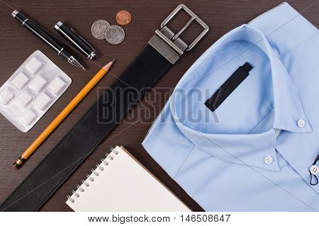 Flat Lay Top View Business Concept. Business Shirt Casual Outfit And Accessory Belt With Pen And Che