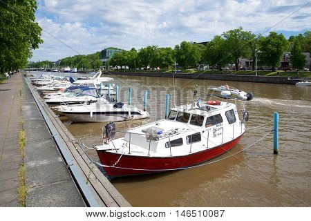 TURKU, FINLAND - JUNE 13, 2015: Sunny june day on the river Aura. Tourist landmark of the city Turku, Finland