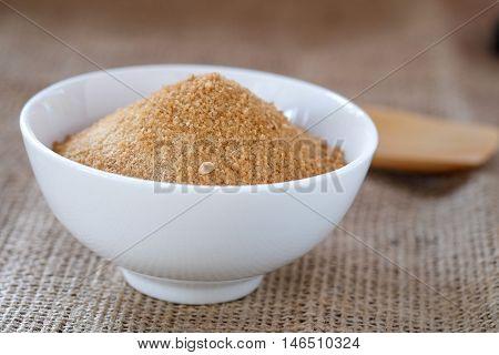 Ginger powder with sugar on sackcloth floor.