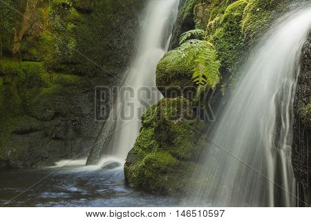 An image of cascading water at Venford Brook twin falls, using a slow shutter speed to create milky water.