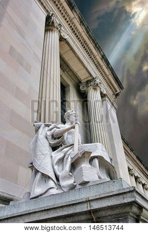 Allegorical figure of Industry, on a Beaux Arts building in Indianapolis. Built in 1905.