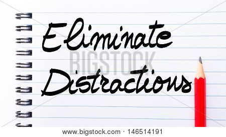 Eliminate Distractions Written On Notebook Page