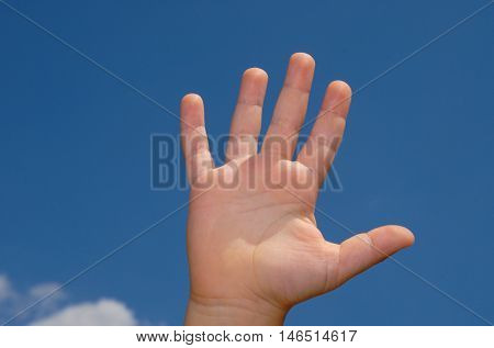 Number five made with hand on the sky