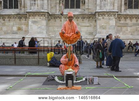 MILAN, ITALY - APRIL 14 2015: Unknown street artists in Milan city center performing a balancing act