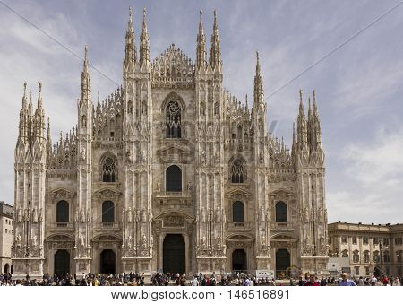 MILAN, ITALY - APRIL 14 2015: Day view of Duomo Cathedral in Piazza del Duomo square in Milan with people around