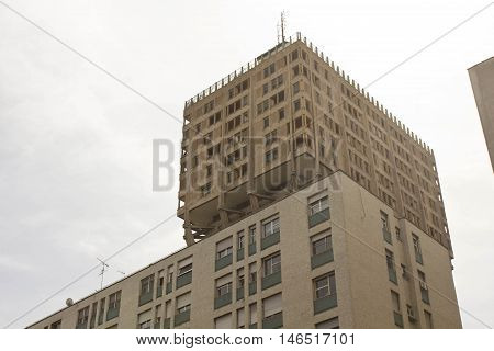 MILAN, ITALY - APRIL 14 2015: The Torre Velasca Velasca Tower in English a brutalist skyscraper built in 1950 in Milan