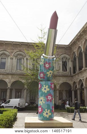 MILAN, ITALY - APRIL 14 2015: Giant sculpture of a lipstick by Alessandro Mendini at Milan Statale University during Milanese Design Week