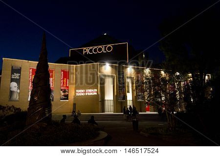 MILAN, ITALY - APRIL 14 2016: Night view of Piccolo Teatro in Milan with person around it in the dark