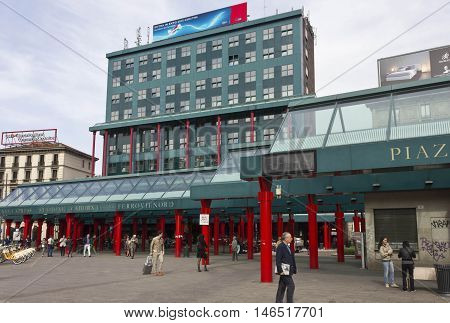 MILAN, ITALY - APRIL 16 2015: Ferrovie Nord building in Piazza Cadorna in Milan train station building with people around