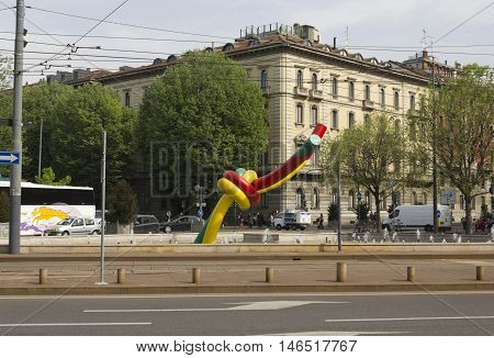 MILAN, ITALY - APRIL 16 2015: Knot giant sculpture in Milan Piazza Cadorna with milanese building in the background