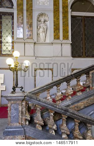 MILAN, ITALY - APRIL 16 2015: Architectural close up of the monumental staircase of Palazzo Arese Litta in Milan with classic statues and marble decorations