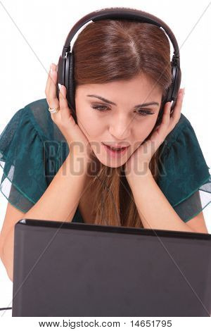 Beautiful young woman  with headphones and laptop  Listening to Music