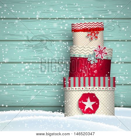 Christmas greeting card with colorful giftboxes in front of blue wooden background, winter theme, vector illustration, eps 10 with transparency and gradient mesh