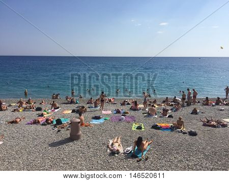 NICE - SEPTEMBER 9: Sunbathers on the beach on September 9, 2016 in Nice, France.