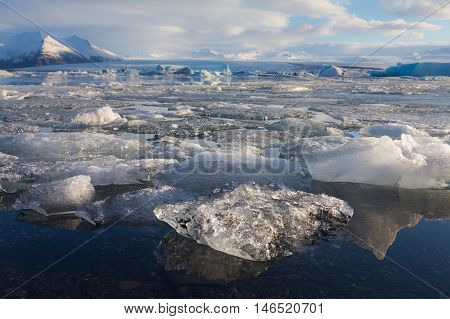 Ice cubes over Jakulsarlon lagoon during late winter, natural landscape background