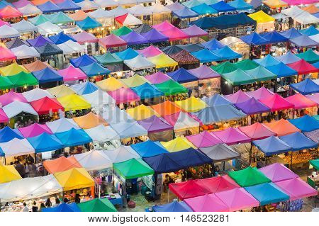 Top view, multiple colour night market roof in Bangkok city Thailand
