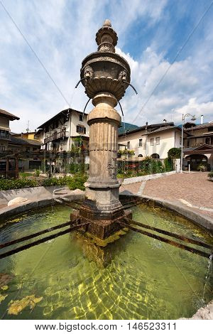 Detail of an ancient marble fountain (1553) in Levico Terme (Venezia Square) Trentino Alto Adige Italy Europe