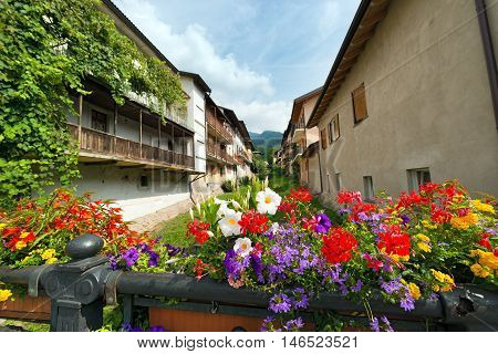 Colorful flowers on a bridge in the small town of Levico Terme Trentino Alto Adige Italy Europe