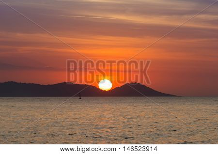 Sunset behind mountain over seacoast, natural landscape background