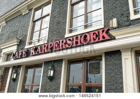 NETHERLANDS - AMSTERDAM - CIRCA MARCH 2014: Logo at café Karpershoek the oldest café in Amsterdam. Started in 1606.