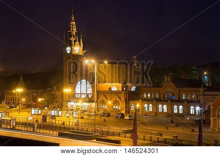 Night view of the building's main train station in Gdansk in the old eclectic style.