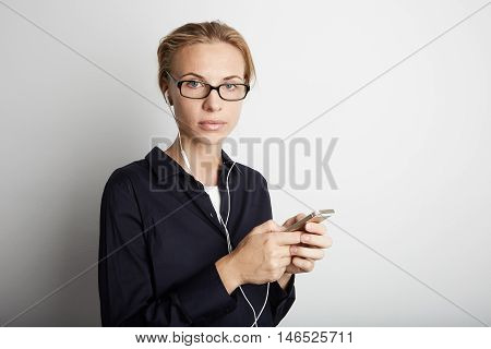 Portrait Handsome Young Woman Glasses Listening Music Smartphone Mobile Headphones Blank White Background.Pretty Girl Enjoy Audio.Beauty Lifestyle Fashion Hipster People Abstract Concept.Empty Space