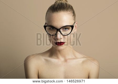 Portrait Handsome Pretty Young Lady Red Lips Wearing Black Classic Glasses Beige Color Empty Background.Beauty Loveliness Fashion People Photo.Sexy Woman Smiling Camera.Studio Shot.Horizontal Image
