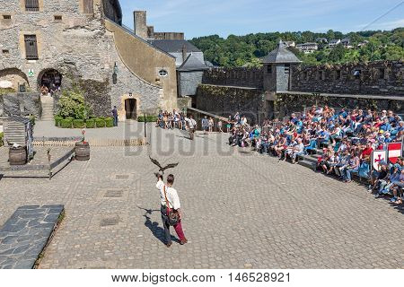 BOUILLON BELGIUM - AUG 13: Bird of prey show on August 13 2016 in medieval castle of Bouillon Belgium