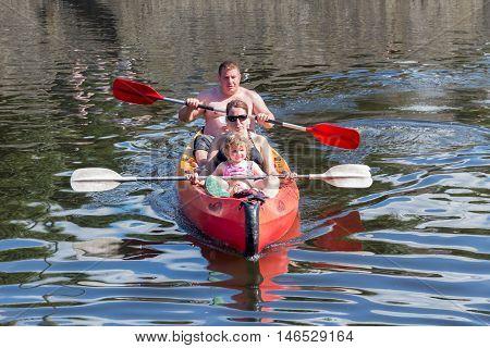 LA ROCHE-EN-ARDENNES BELGIUM - AUG 13: Family in Kayak on August 14 2016 at river Ourthe near La Roche-en-Ardenne Belgium