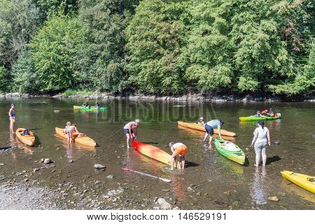 BOUILLON BELGIUM - AUG 25: People preparing a departure with kayaks for a trip on the river Semois on August 25 2016 near Bouillon Belgium