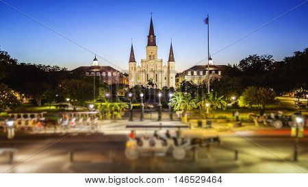 St Louis Cathedral and Jackson Square in New Orleans French Quarter as night falls in Louisiana (People blurred for commercial use)